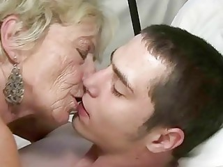 granny and lad enjoying hard sex