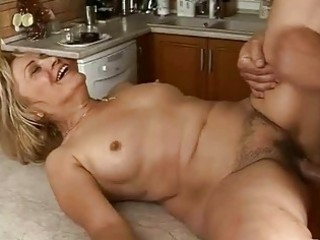 lusty granny receives fucked hard in the kitchen