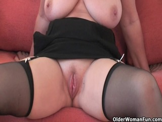 attractive grandma in nylons shows her large