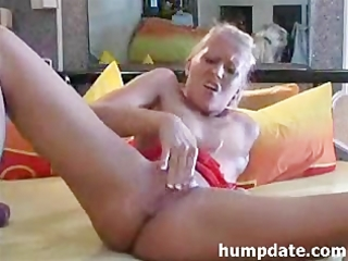 blond milf inserts a huge dildo in her pussy