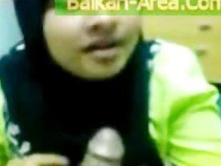 devout pakistani wife in dark burqa engulfing