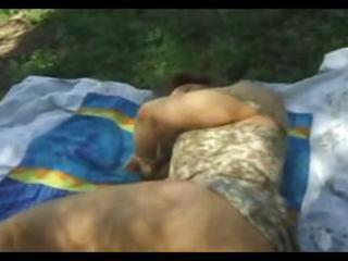 brunette hair wife is taking a nap outdoors