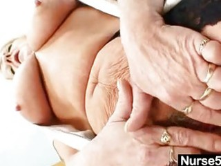 grandma in uniform spreads golden-haired unshaved