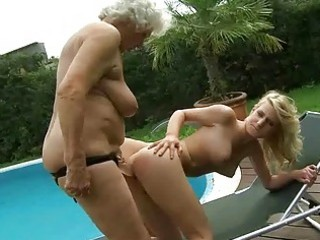 busty granny enjoys lesbian sex with legal age