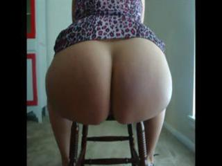 mature non-professional brunette hair sits on a