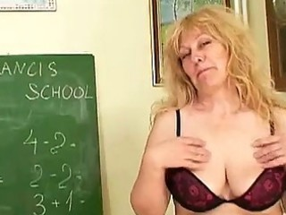 older blond teacher with giant tits inserting an