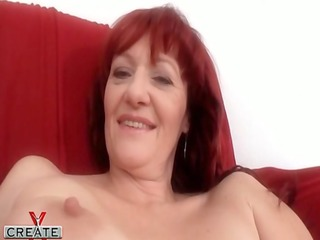 german mature redhead plays with her curly vagina