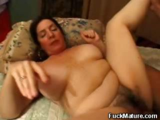 fat aged brunette rubs her big tits and acquires